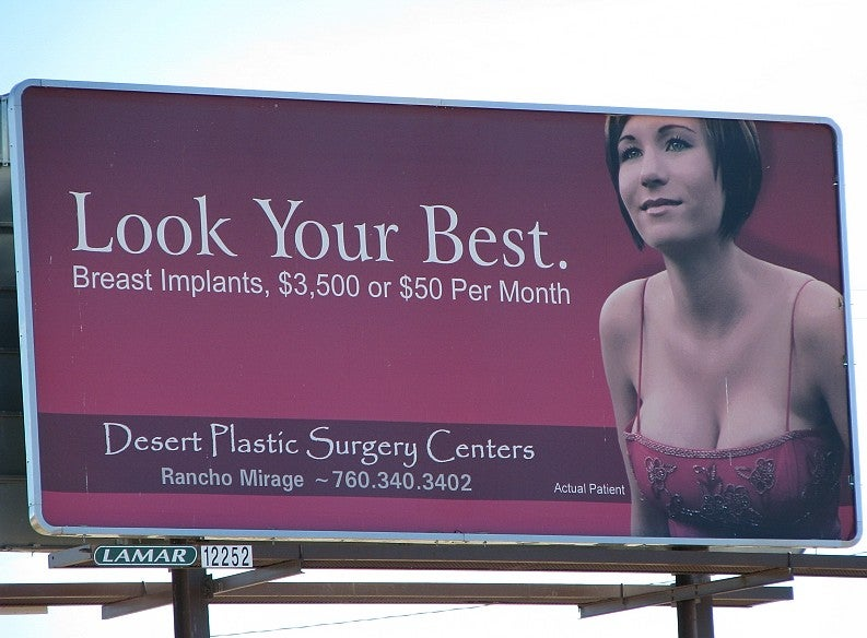 discounted breast implants on a billboard
