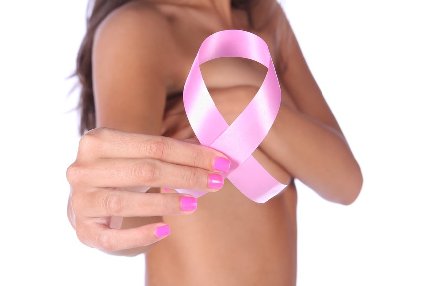 pink ribbon awareness breast cancer woman covering breasts