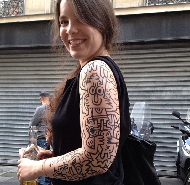 This is not a real tattoo -- an artist drew it on with a marker.