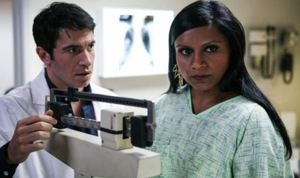 woman weighing self with doctor mindy kaling