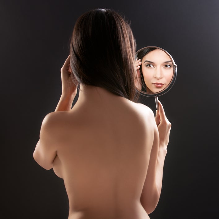woman in mirror what will i look like after breast cancer surgery