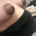 Taken from the left side to show the shape of the right breast