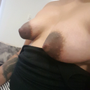 Taken from the right side to show the shape on the left breast