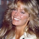 Lower tooth show, like Farrah Fawcett had, should be possible with a procedure.