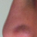 Left side tip of the nose. It is bigger right at the tip. I would like to make it look similar to the right tip.